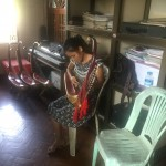 Practicing the saung (Burmese harp)
